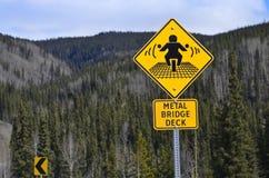 Warning road sign for motor-bikers. Road sign, warning motor-bikers at bridge with metal deck Royalty Free Stock Photos