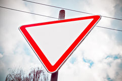 Warning road sign in red triangle Stock Photos