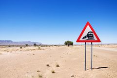 Warning of road sign - trains crossing the road Royalty Free Stock Photo