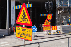 Warning roadsigns along urban road. Sweden. Warning roadsigns along urban road. Swedish text means intersecting bicycling royalty free stock images
