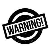 Warning rubber stamp. Grunge design with dust scratches. Effects can be easily removed for a clean, crisp look. Color is easily changed Stock Image
