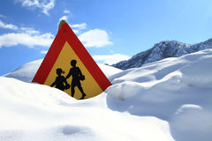 Warning school sign. On snow Royalty Free Stock Photos