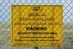 Warning security restricted area yellow sign. Warning security restricted area unauthorized access prohibited, offenders are liable to removal and arrest Stock Photos