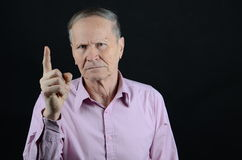 Warning. Senior pointing not to do something Stock Images