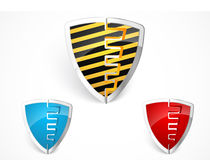 Warning shield merge with yellow stripes Stock Photos