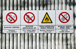 Warning sign. An image of a warning sign in dual language, English & Malay royalty free stock photography