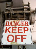 Warning sign. Do not climb on this equipment. It is dangerous! Use for insurance, liability, claims, medical, accident, trespass, etc stock images