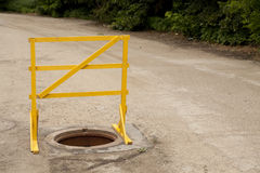 Warning sign. Protects from falling into a sewerage hole Stock Photography
