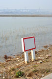 Warning sign. On the bank of pond stock image