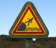 Warning sign. Drop to the sea Royalty Free Stock Photography
