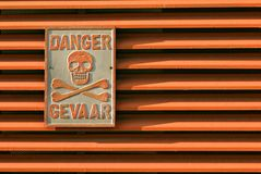 Warning sign. A warning sign on a generator house in South Africa Stock Images