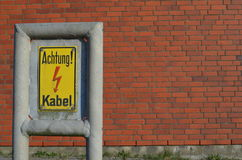 Warning sign: Achtung Kabel / Caution cable Royalty Free Stock Images