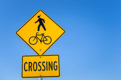 Warning Sign against Pedestrian and Bicycle Crossing Stock Photo