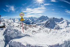 Warning sign of avalanche danger. Beautiful winter landscape with snow-covered mountains. Ski resort Elbrus. Caucasus Stock Photo