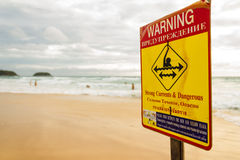 Warning Sign on the beach Stock Photo