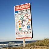 Warning sign on beach. Royalty Free Stock Image