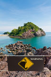 Warning sign at beauty Island Stock Photo