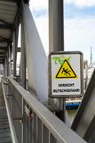 Warning sign on a bridge not to Slip and Fall stock photography