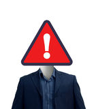 Warning sign on businessman Stock Photography