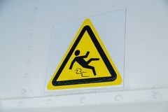 Warning sign, caution wet floor. At white wall Stock Photography