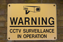 Warning sign CCTV surveillance. Yellow and black warning sign CCTV surveillance Royalty Free Stock Image