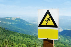 Warning sign on a cliff. On the mountain Royalty Free Stock Photography