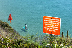 Warning sign on cliff Stock Image