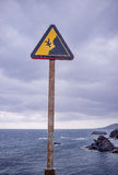 Warning sign on cliff Royalty Free Stock Photo