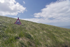 Warning sign on coastal path near Worbarrow Bay Royalty Free Stock Image