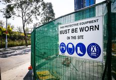 Warning sign construction site for must be worn this protective equipment on this site. stock photo