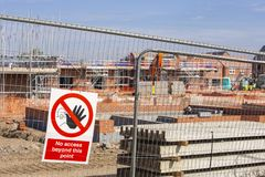 Warning sign on a construction site for newly build homes in Eng. No access warning sign on fence at a building site in England United Kingdom Europe stock images