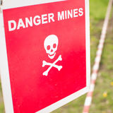 Warning sign - Danger mines on a forest Stock Photos