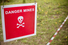 Warning sign - Danger mines on a forest Royalty Free Stock Photography