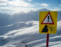 Warning sign of danger in mountains Royalty Free Stock Images