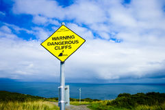 warning sign for dangerous cliffs Stock Images