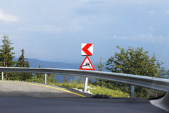 Warning sign on dangerous mountain road. Warning traffic signs before right turn on dangerous mountain road Royalty Free Stock Images