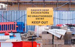 Warning sign for deep excavtion on maintenance site Royalty Free Stock Image