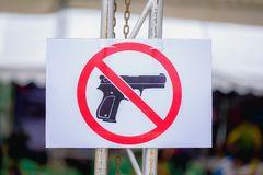 Warning sign Do not carry guns seen in public. royalty free stock photos