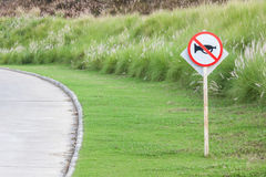 The warning sign do not use vehicle horn with flowering grass ba Stock Photo