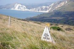 Warning sign on Dorset Coastal path. Near Tyneham Royalty Free Stock Photos