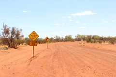 Warning sign for dry weather road only, unsealed traveling in the Australian Outback Stock Photo