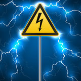 Warning sign. Electrical hazard. Fenced danger zone. pillar with sign. Lightning strikes.  Stock Photography