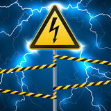 Warning sign. Electrical hazard. Fenced danger zone. A pillar with a sign. Lightning strikes. Flash arcing. Fantastic Royalty Free Stock Image