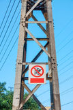 Warning sign on electrical power pole Stock Photos