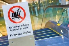 Warning sign before escalator Royalty Free Stock Image