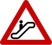 Warning sign with escalator Stock Photos