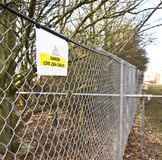 Warning sign on fence 2 Stock Image