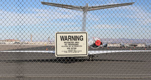 Warning sign. On the fence around the airport Stock Image