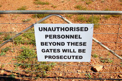 Warning sign on fence in Australia. Warning sign on fence near mine in Cobar town, Australia Stock Photos