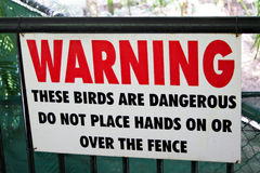 Warning sign on fence for dangerous large birds. Close up of a warning sign at an Australian zoo, warning of the cassowaries on the other side of the fence Stock Images